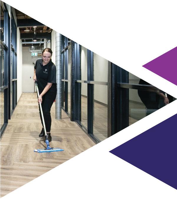 Priority One team member mopping commercial building floor