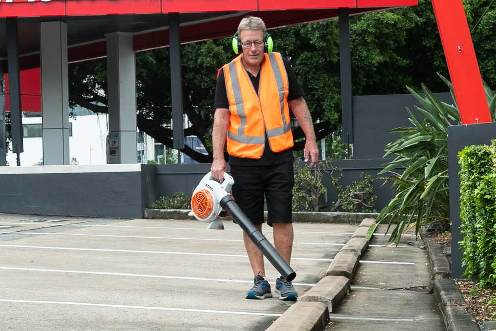 Priority One team member maintaining and cleaning the Beaumont Tiles store car park